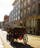Horse and Carriage 'Caleche' tour. Horse and carriage tour down historic St Paul Street in the old port of Montreal, now threatened by a ban royalty free stock image