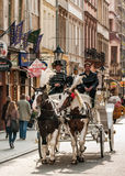Horse carriage carrying tourists in the streets in Krakow. Royalty Free Stock Photo