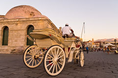 Horse carriage in Chania harbor at sunset, Crete Royalty Free Stock Images