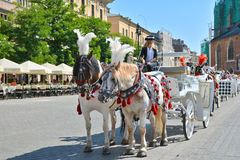 Horse carriage for city sightseeing tours in Krakow Stock Photo