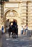 Horse drawn carriage and town gate, Mdina. Stock Image