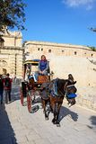 Horse drawn carriage by town gate, Mdina. Stock Images