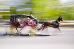 Horse and carriage drives in traffic down Central Park West in Manhattan, New York City, NY Stock Photo