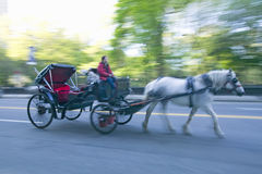 Horse and carriage drives in traffic down Central Park West in Manhattan, New York City, NY Royalty Free Stock Photography