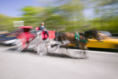 Horse and carriage drives in traffic down Central Park West in Manhattan, New York City, NY Royalty Free Stock Photos