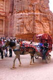 Horse carriage in front of the ancient Treasury in Petra, Jordan Stock Images