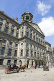 Horse and carriage in front of royal palace Amsterdam Royalty Free Stock Photography