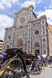 Horse carriage in front of Santa Maria del Fiore cathedral at san Giovanni square in Florence, Tuscany Stock Photography