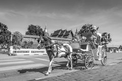 Horse carriage front of Wat Phrathat Lampang temple Stock Images