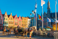 Horse carriage on Grote Markt square of Bruges Royalty Free Stock Photography