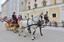 Horse and carriage at Kapitelplatz, Salzburg Stock Photo