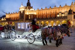Horse carriage at Main square in Krakow, Poland stock photos