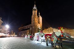 Horse carriage at Main square in Krakow, Poland stock image