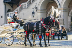 Horse and carriage at the Main Square in Krakow. KRAKOW, POLAND - OCT 7, 2014: Horse and carriage at the Main Square in Krakow Royalty Free Stock Photo