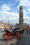 Horse carriage on the Market square in Bruges, Belgium Stock Photos