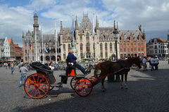 Horse carriage on the Market square in Bruges, Belgium Royalty Free Stock Photo