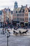 Horse carriage in Market Square in Bruges, Belgium. Horse carriage in Market Square in the UNESCO World Heritage Old Town of Bruges, Belgium Stock Photo