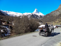 Horse carriage and Matterhorn in Zermatt, Switzerland . Royalty Free Stock Photo
