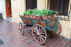 Horse carriage. Old hand painted horse carriage full of flowers Royalty Free Stock Photo