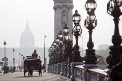 Horse carriage on the Parisian bridge Alexandre III Stock Images