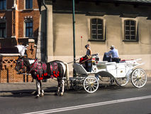 A Horse and Carriage ride through the streets of Krakow Poland Stock Photos