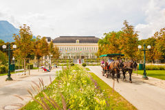 Horse carriage rides through the park in front of  the Congress Royalty Free Stock Image
