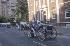 Horse and carriage riding in historic district of old Philadelphia, PA, in front of Independence Hall, home of Declaration of Inde Royalty Free Stock Photos