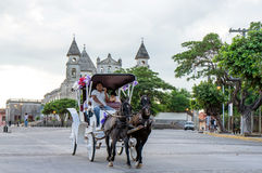 Horse Carriage Riding Past La Merced Church, Granada Nicaragua Stock Images