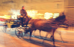 Horse carriage is running along the street of Vienna Stock Photography