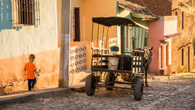 Horse carriage on streetside in Trinidad, Cuba at sunset. Trinidad, Cuba on December 29, 2015: In late afternoon light a horse carriage is waiting for passengers Stock Photography
