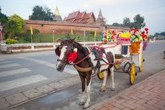 Horse carriage in temple Phrathat Lampang Luang in Lampang, Thai Stock Photo