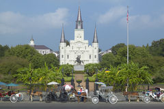 Horse Carriage and tourists in front of Andrew Jackson Statue & St. Louis Cathedral, Jackson Square in New Orleans, Louisiana Stock Images