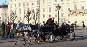 Horse carriage with tourists in Heldenplatz Stock Photos