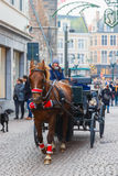 Horse carriage on Markt square of Bruges. Bruges, Belgium - December 26, 2014: Horse carriage and tourists on Grote Markt square of Brugge Christmas. Belgian Stock Photo