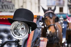 Horse carriage in Vienna, Austria with bowler on light Royalty Free Stock Photography