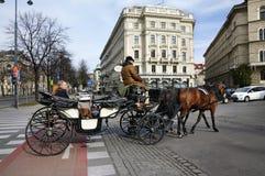Horse Carriage. Vienna, Austria. Traditional horse riding in a  Fiaker through the city center. Vienna, Austria Royalty Free Stock Photos