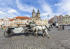 Horse Carriage waiting for tourists at the Old Square in Prague. Stock Photos
