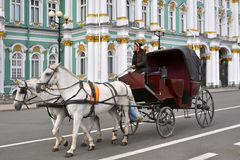 Horse carriage, Winter Palace, St.Petersburg. The central square in the heart of Saint-Petersburg: a coach with horses on the Winter Palace square, in front of Stock Image