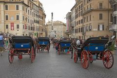 Horse and carriages awaiting tourists at Spanish Steps of Rome, Italy Stock Image