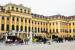 Horse carriages fiaker in front of the Schonbrunn Stock Photo