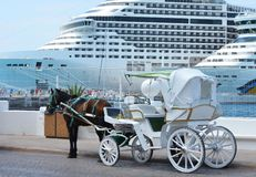 Horse carriages in front of cruise liners Stock Photos