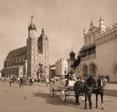 Horse carriages in front of Mariacki church Krakow Royalty Free Stock Photos