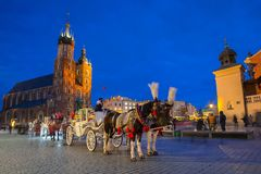 Horse carriages at the Main Square in Krakow. Poland Royalty Free Stock Image