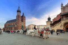 Horse carriages at the Main Square in Krakow Stock Images