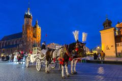 Horse carriages at the Main Square in Krakow Stock Photos