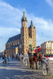 Horse and carriages at the Main Square in Krakow Royalty Free Stock Photo