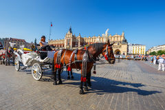 Horse carriages at main square in Krakow in a summer day, Poland Stock Photography
