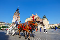 Horse carriages at main square in Krakow in a summer day, Poland Stock Photo