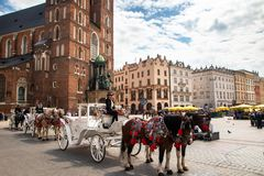 Horse carriages at the main square Rynek Glowny in Krakow old town stock images