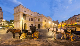 Horse carriages  near ayuntamiento in morning. Seville Stock Photo